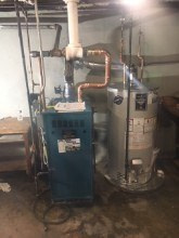 220. Burham Boiler with Bradford White Water Heater